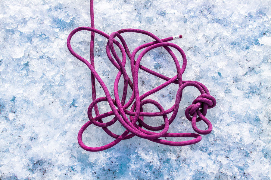 Climbing rope at glacier. Buarbreen Climbing Climbing Rope Cold Temperature Crashed Ice Day Directly Above Entangled Folgefonna Glacier Glacier Hike High Angle View Ice Ice Climbing Mountain Climbing No People Node Outdoors Pink Color Red Rope Rubber Band The Great Outdoors - 2017 EyeEm Awards