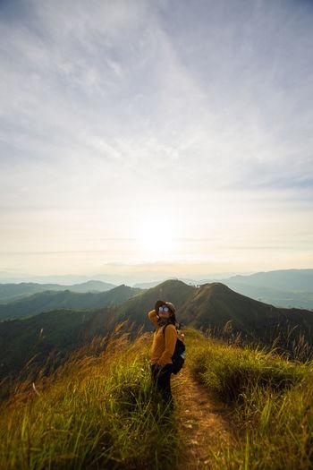 Man on field against mountain range