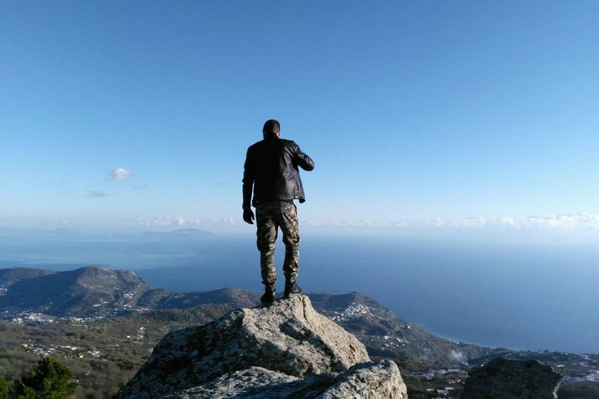 Miles Away One Person Mountain Adventure King Of The World EyeEmNewHere Bestoftheday Sea Sea And Sky One Man Only Exploration Landscape Scenics Adults Only Outdoors Mountain Peak Rear View Climbing Sky Justaploretarian Onlylowqualityphotos Travelling Travel Sunset Beauty In Nature