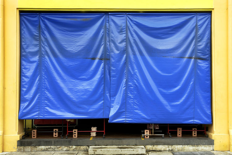 Clothes in blue curtain
