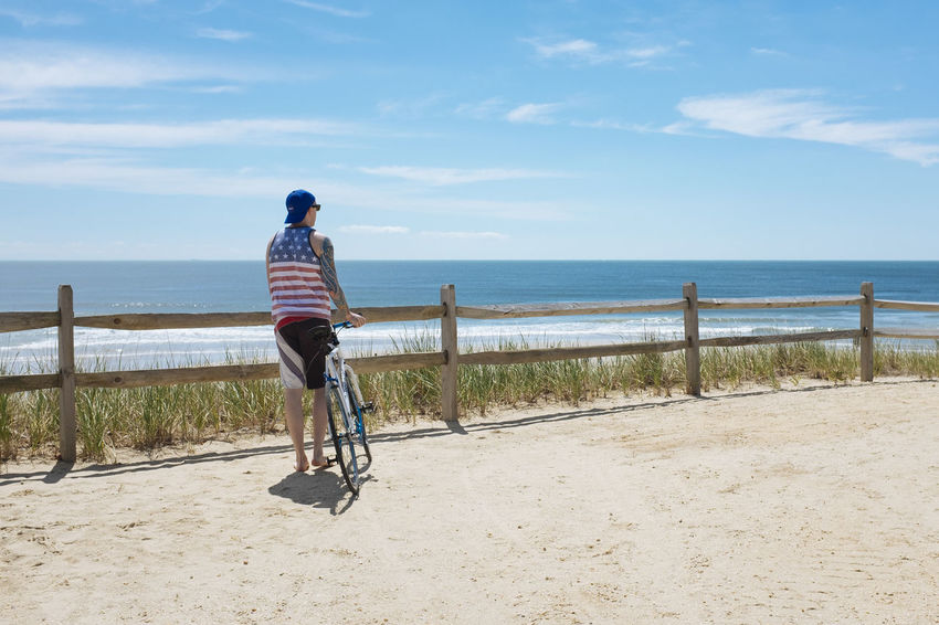 Cyclist Rides to the end of Long Beach Island in New Jersey New Jersey Beach Beauty In Nature Bicycle Casual Clothing Day Full Length Horizon Over Water Leisure Activity Long Beach Island Men Nature One Person Outdoors People Real People Sand Scenics Sea Shore Sky Tranquil Scene Vacations Water