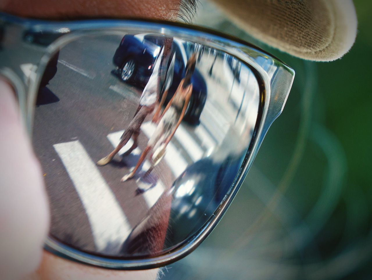 reflection, transportation, mode of transport, one person, real people, land vehicle, side-view mirror, human body part, day, car, outdoors, close-up, road, human hand, lifestyles, men, people