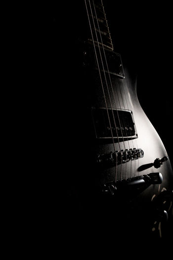 My second passion... Low Key Photography Low Key The Week On EyeEm Arts Culture And Entertainment Blackandwhite Electric Guitar Eye4photography  Guitar Illuminated Modern Rock Monochrome Music Musical Instrument Musical Instrument String Musician Rock Music