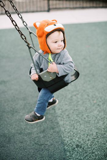 Full length of boy wearing hat in water