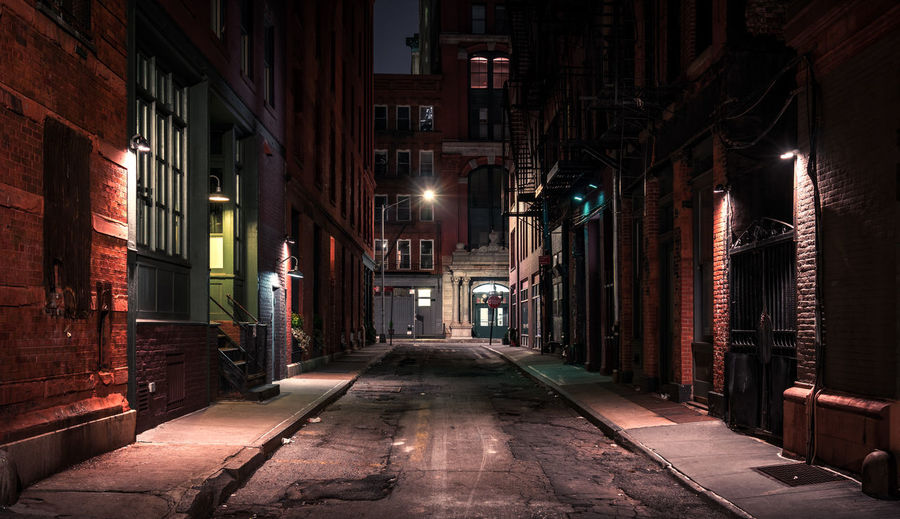 New York city dark street at night Reinaroundtheglobe Architecture Built Structure Building Exterior Illuminated The Way Forward Direction Building Night Lighting Equipment Street City No People Empty Street Light Alley Absence Diminishing Perspective Electric Lamp New York Abbandoned NYC Dark Moody Sky Road Empty Road Urban Scene