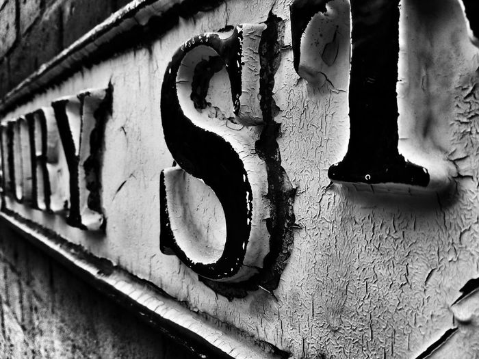Black And White Street Sign Close Up Walking Around Town