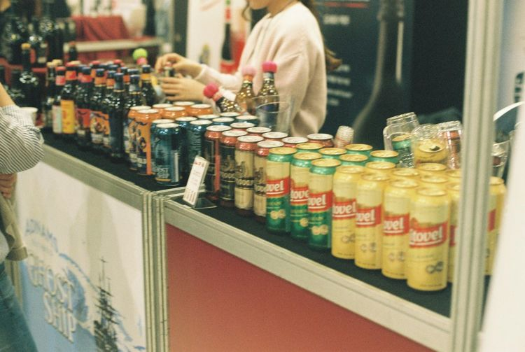 Film Nikon Abundance Adult Bottle Business Choice Container Customer  Film Photography Food Food And Drink In A Row Indoors  Large Group Of Objects One Person Real People Refreshment Retail  Shopping Store Variation