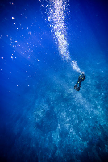 green island, Taiwan Adventure Aquatic Sport Beauty In Nature Blue Day Diving Flipper Extreme Sports Leisure Activity Lifestyles Nature One Person Outdoors People Real People Scuba Diver Scuba Diving Sea Sport Swimming UnderSea Underwater Underwater Diving Water
