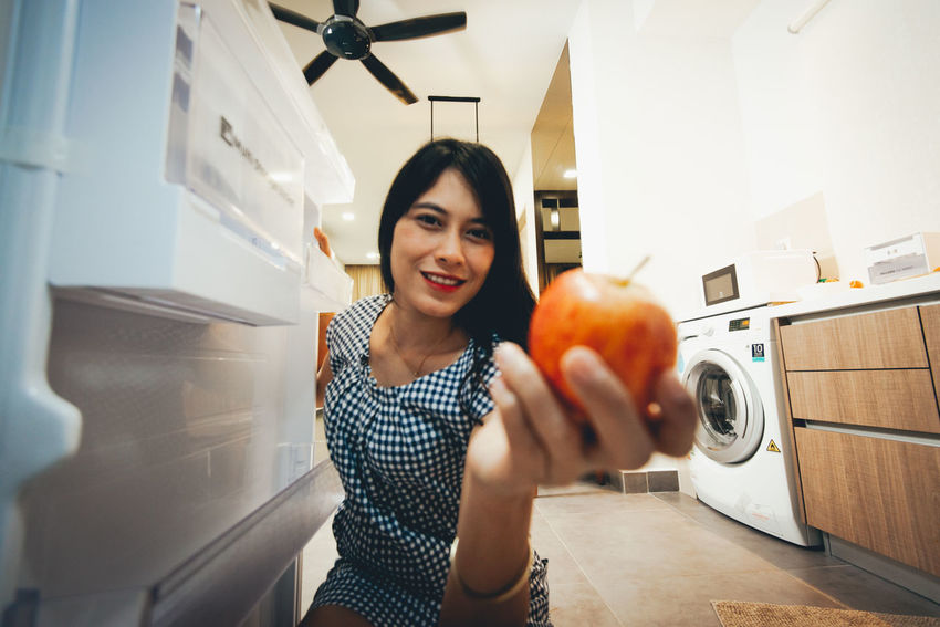 One Person Portrait Lifestyles Front View Indoors  Real People Women Casual Clothing Smiling Appliance Looking At Camera Holding Leisure Activity Machinery Standing Young Women Household Equipment Young Adult Hairstyle