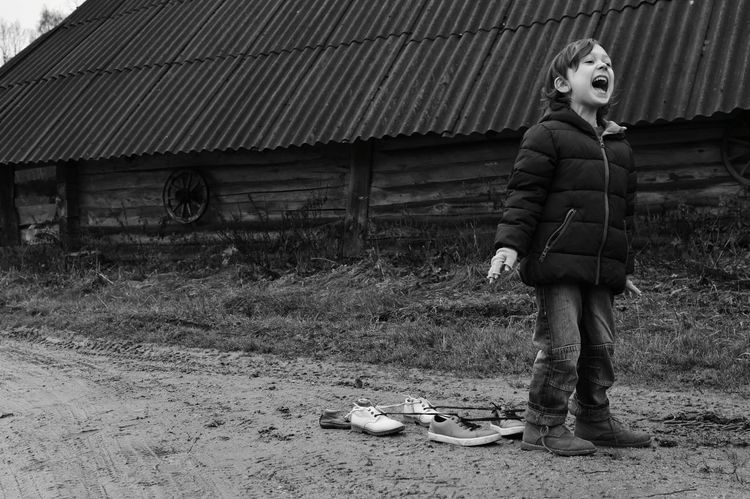 Farmstead One Person Casual Clothing Portrait Full Length Outdoors Warm Clothing Growing Childhood Child Boy Kid Day Playing Leisure Activity Shoe Elementary Age Lonely Loneliness Blackandwhite Black And White Lithuania Screeming Black And White Friday Visual Creativity