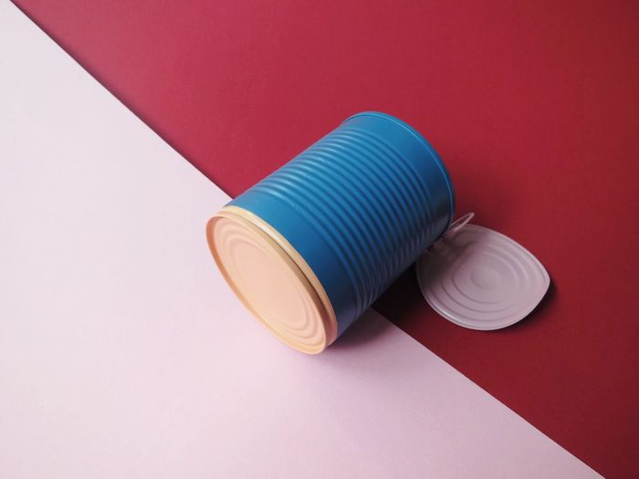 High angle view of blue tin on table