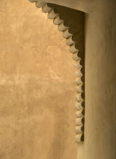 architectural close up on an ocher wall in an omani fort 1000 And 1 Night Acient Arabic Fort Ancient Architecture Arabic Architecture Arabic Fort Architectural Close Up Architectural Detail In Windows Clay Wall Close-up Day Jabreen Castle No People Ocher Color Oman_photo