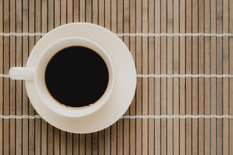 High angle view of black coffee on table