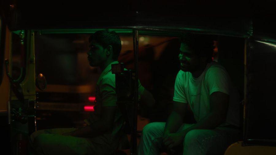 People sitting in illuminated bus