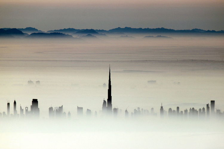 High Section Burj Khalifa And Skyscrapers During Foggy Weather