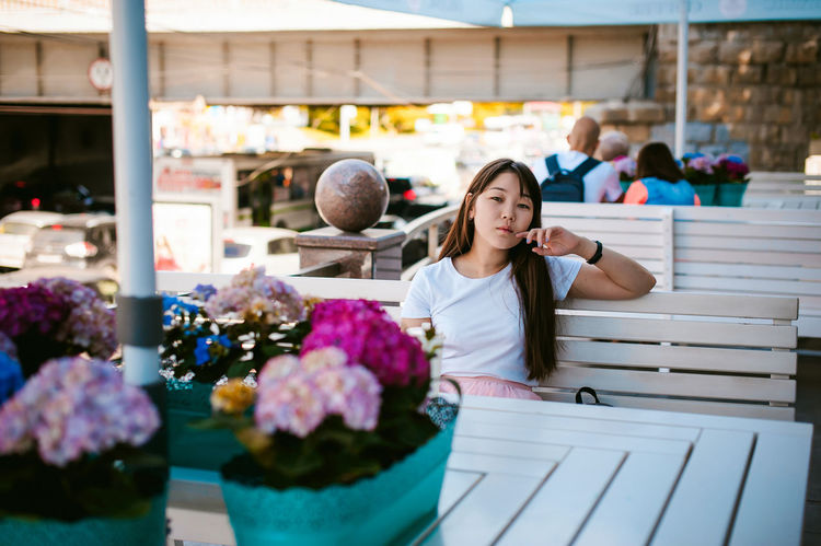 Adult Beautiful Woman Business Casual Clothing Cheerful Day Florist Flower Flower Shop Freshness Front View Happiness Indoors  Looking At Camera Multi Colored One Person People Portrait Real People Retail  Smiling Standing Store Young Adult Young Women