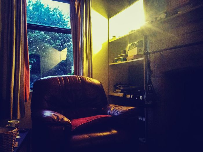 We just tried to find something decent to watch on the box and as usual entertainment isn't great. Empty/ abandoned seat! Interior Style Shelves Darkness And Light Dark Light And Shadow Indoor Photography Indoors  Trees Reflections Reflection Window Dazzle Chair Sofa Seat Lounge Interior Views Interior Interior Design Textures And Surfaces Pivitol Ideas Colour Of Life Colour Palette Shadow Bright
