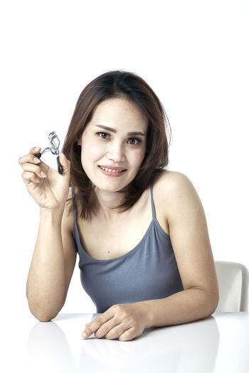 Asian  Thai 30-34 Years Indian Korean Japanese  Curler Eyelash Woman Young Beautiful Beauty Female Tool Portrait Eyelashes Girl Caucasian Attractive Natural Adult Isolated Face Makeup Hand Care Model Mascara Fashion Curling Eye Pretty person Cosmetic Skin Lashes Long Hair Glamour Eyes Looking At Camera One Person Indoors  White Background Smiling Front View Young Adult Beautiful Woman Women Young Women Holding Studio Shot Lifestyles Sitting Casual Clothing Leisure Activity Hairstyle