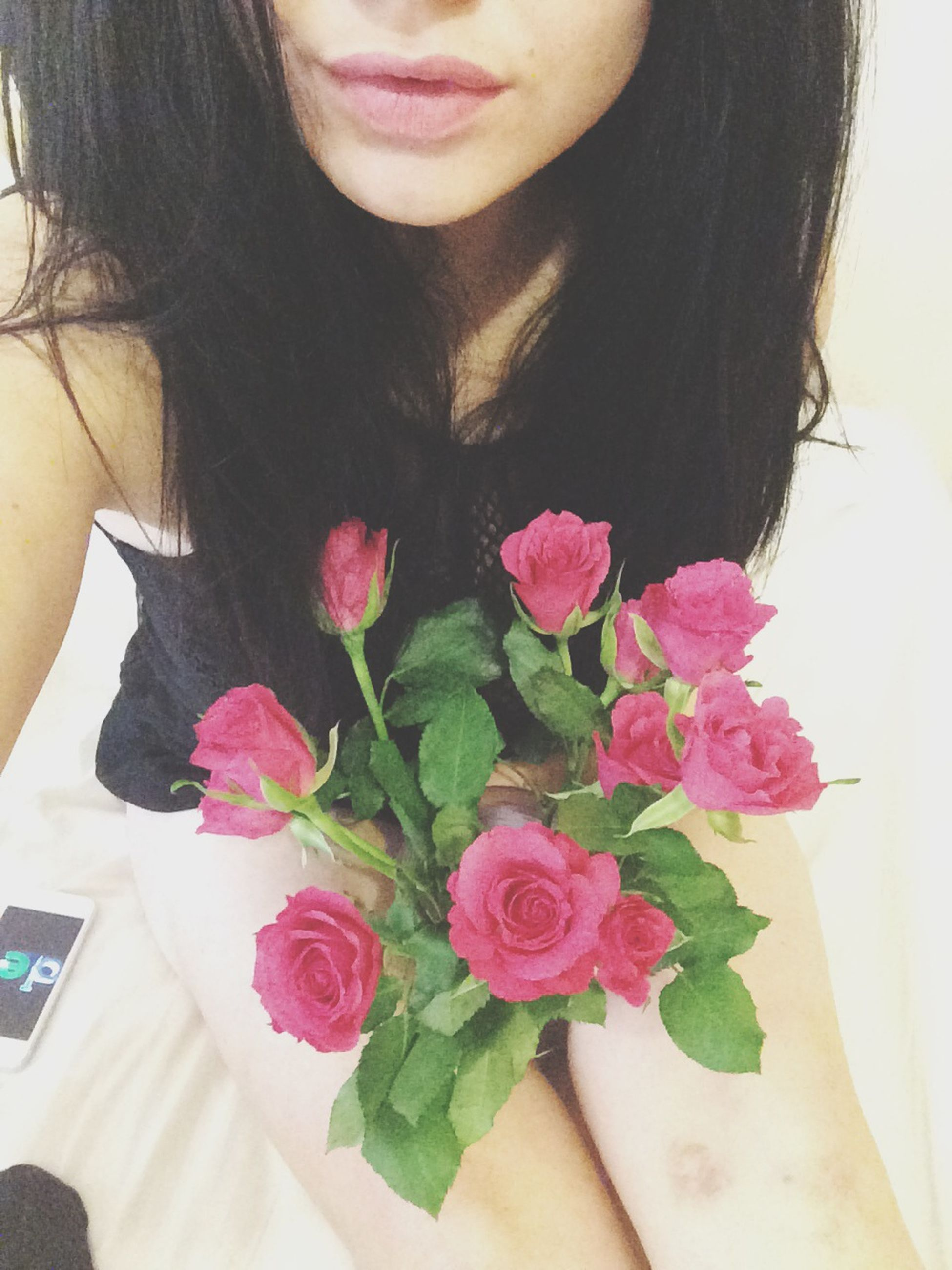 flower, indoors, lifestyles, young women, young adult, freshness, person, leisure activity, pink color, front view, fragility, bouquet, red, holding, long hair