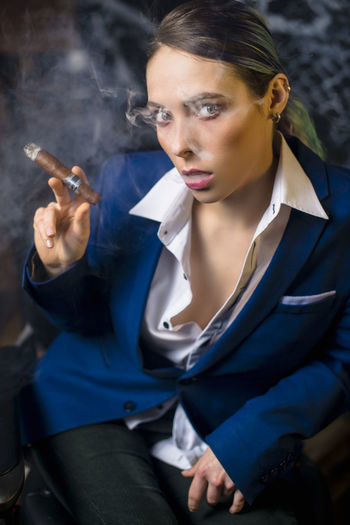 Portrait of man smoking cigarette