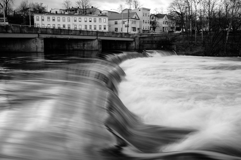Blurred motion of dam on river