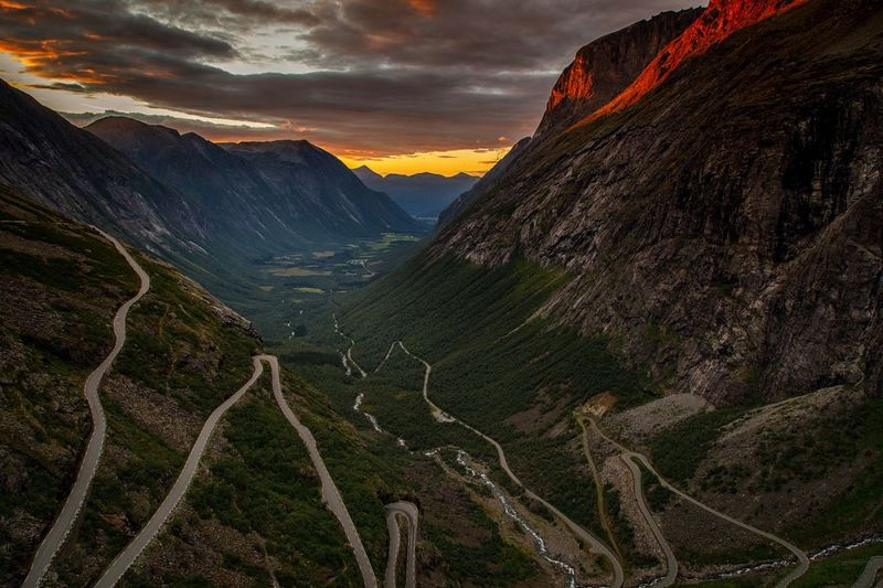 Trollstigen Road Norway Trollstigen Scenics - Nature Landscape Environment Mountain Beauty In Nature Sky Tranquil Scene Land Nature Tranquility Sunset No People Cloud - Sky Idyllic Mountain Range Outdoors