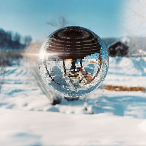 Close-up of crystal ball on snow