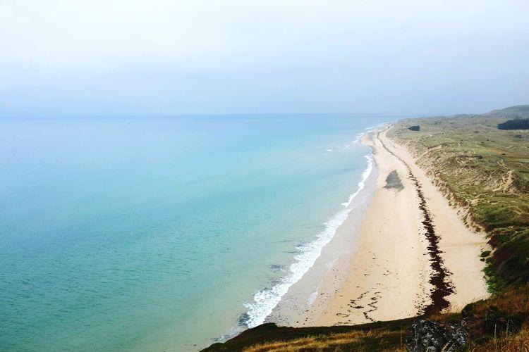 Plage de la vieille église Barneville-carteret Normandie Normandy Marram Grass Blue Sky Seascape Coastline Sandy Beach Turquoise Ocean Bay Surf Turquoise Colored Island Horizon
