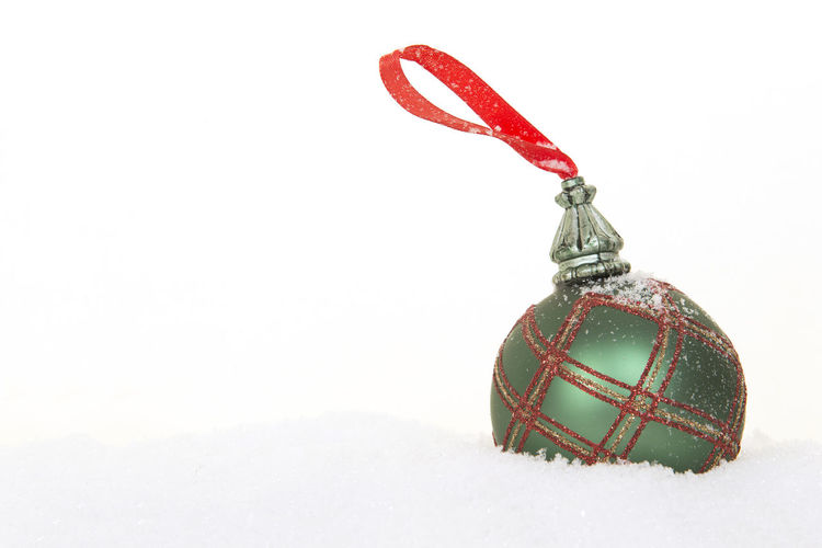 Red and green christmas ball in white snow and on a white background in a vertical image Christmas Copy Space Holidays Background Christmas Background Christmas Ball Christmas Ornament Green And Red Snow