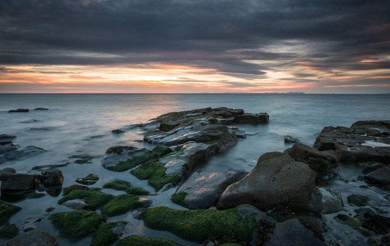 Blue hour on the Cumbrian Coast Blue Hour Cumbria Beach Beauty In Nature Cloud - Sky Coast Colour Dusk Horizon Over Water Moody Nature No People Outdoors Rocks Sandstone Scenics Sea Sky Sunset Tourism Tranquil Scene Tranquility Water Wave Whitehaven