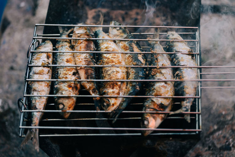 High angle view of fish being grilled on barbecue