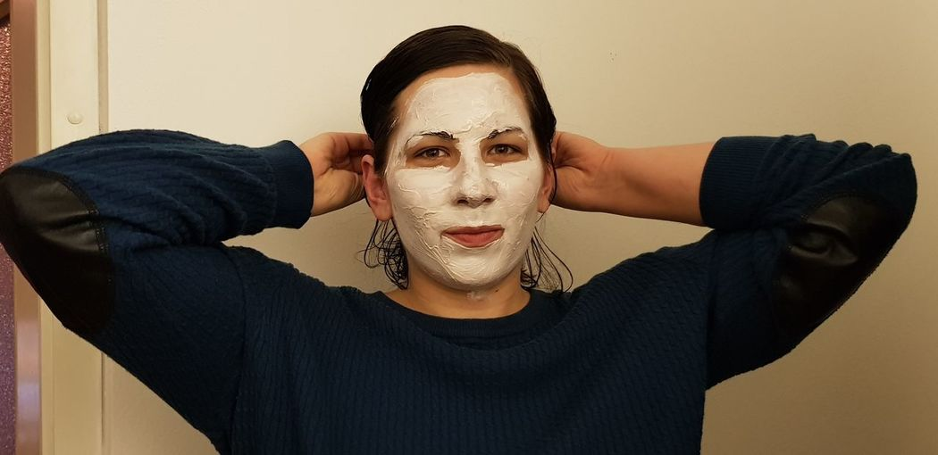 Portrait Of Young Woman With Face Mask At Home