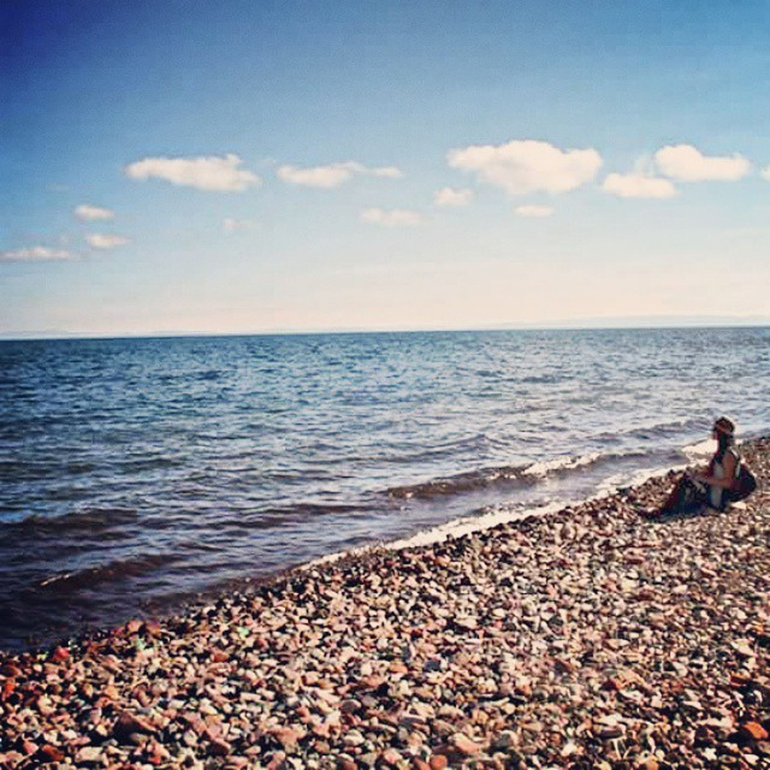 sea, water, horizon over water, sky, beach, scenics, shore, beauty in nature, tranquility, tranquil scene, nature, rock - object, leisure activity, stone - object, idyllic, cloud - sky, lifestyles, pebble