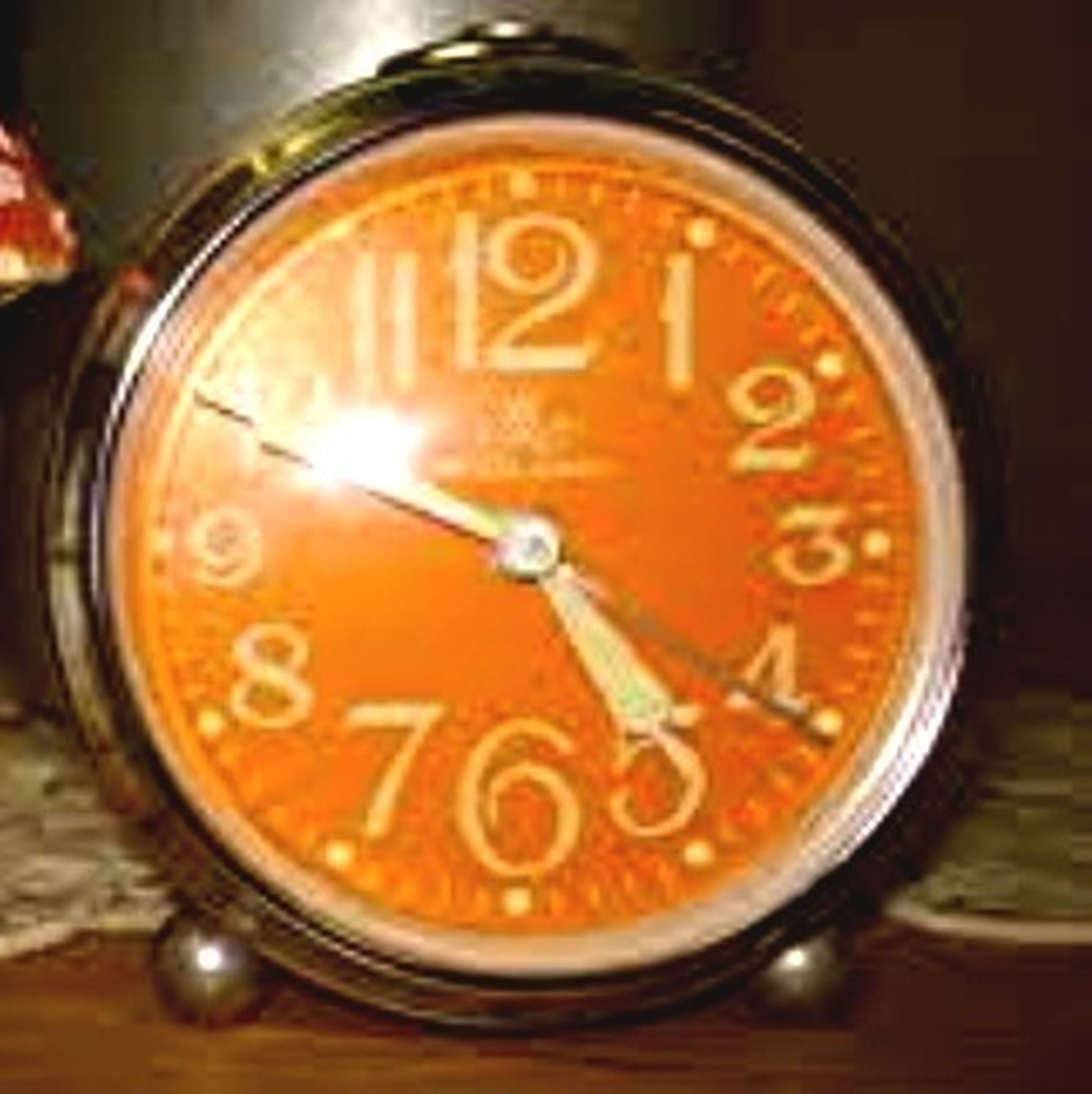 close-up, text, indoors, communication, western script, number, time, still life, clock, focus on foreground, circle, single object, table, no people, glass - material, selective focus, metal, old-fashioned, accuracy, instrument of time