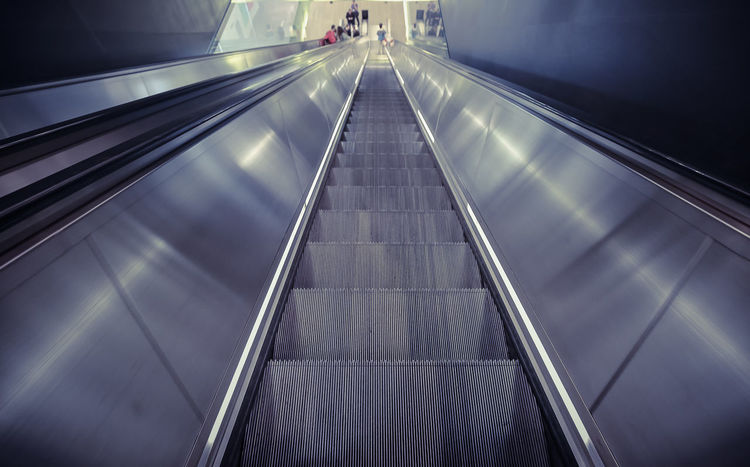 Bestseller  Convenience Diminishing Perspective Down Empty Escalator Futuristic Illuminated Low Angle View Modern Moving Down No People Repetition Staircase Steel Tate The Way Forward Vanishing Point