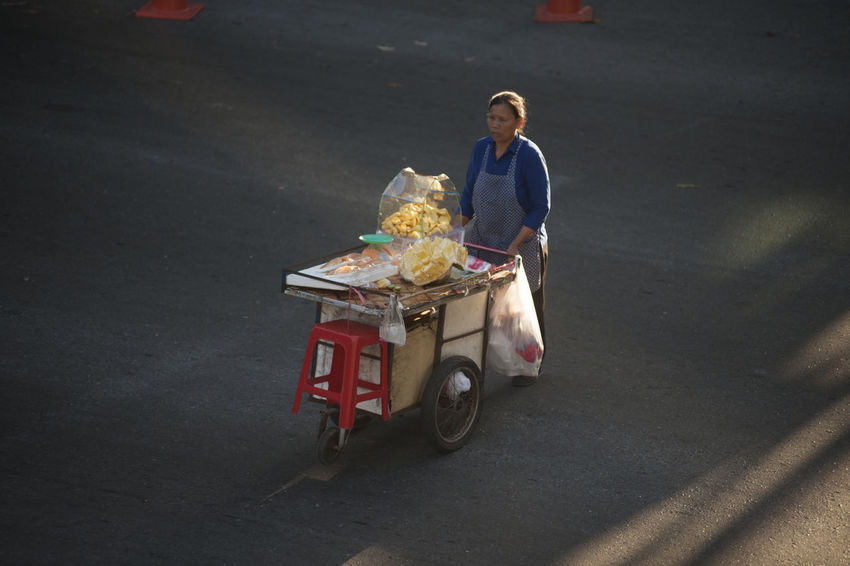 Female sell jackfruit on the street in Bangkok. Bangkok Barrow Delivery Road Shadows & Lights Thailand Transportation Trolley Adult Cart Day Female Food Fruit Full Length High Angle View Jackfruit One Person Outdoors People Real People Seller Street