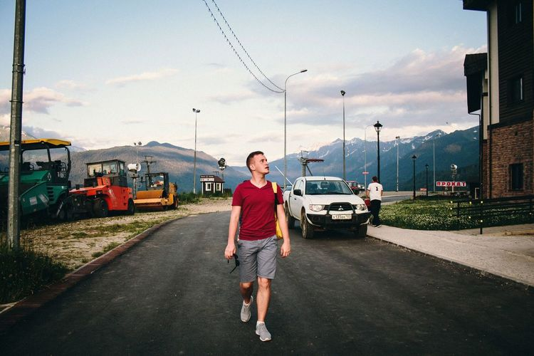 Be. Ready. Transportation Mode Of Transportation One Person Sky Cloud - Sky Full Length City Casual Clothing Road Real People Men Land Vehicle Street Day Standing Motor Vehicle Car Architecture Building Exterior Nature Outdoors Russia Sochi Mountains