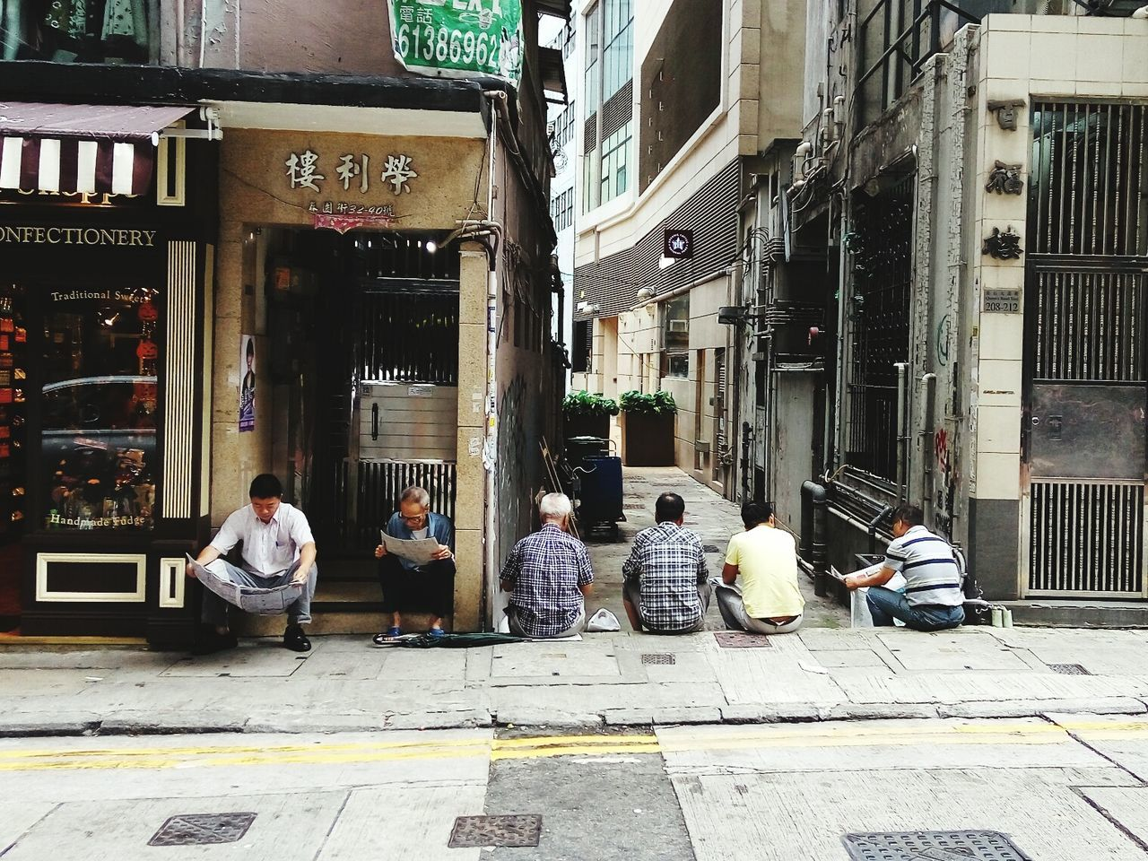 building exterior, architecture, built structure, real people, men, outdoors, day, women, sidewalk, street, city, sitting, large group of people, people