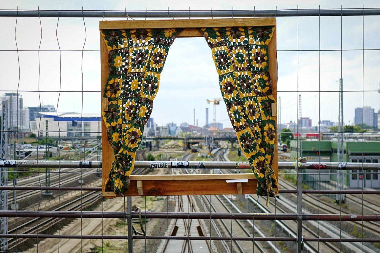 Temporary window at railing of footbridge