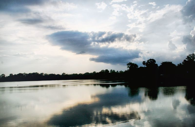 Reflection Sky Water Tree Lake Nature Silhouette No People Cloud - Sky Outdoors Scenics Beauty In Nature Day Cloudy Waterfront Canonphotography Srah Srang Siemreap in Cambodia TCPM Lost In The Landscape