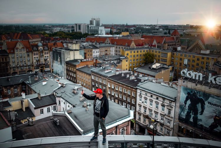 Architecture Building Exterior Built_Structure City High Angle View Outdoors Cityscape Day Men Roof Headwear One Person Helmet Real People One Man Only Sky Only Men People The Week On Eyem EyeEm Gallery Rooftop Poznań The Architect - 2017 EyeEm Awards The Great Outdoors - 2017 EyeEm Awards Let's Go. Together. Sommergefühle EyeEm Selects Your Ticket To Europe