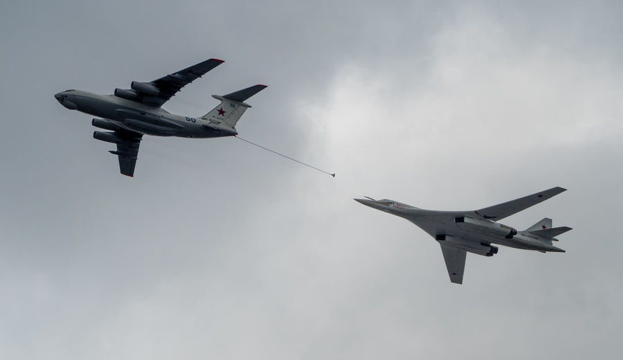 Russia, Moscow, Airshow, victory day, a military parade, refueling in the air, White Swan Air Vehicle Airplane Airshow Blue Cloud Cloud - Sky Cloudy Day Fighter Plane Flying Helicopter Low Angle View Mid-air Military Airplane Mode Of Transport Nature No People On The Move Outdoors Sky