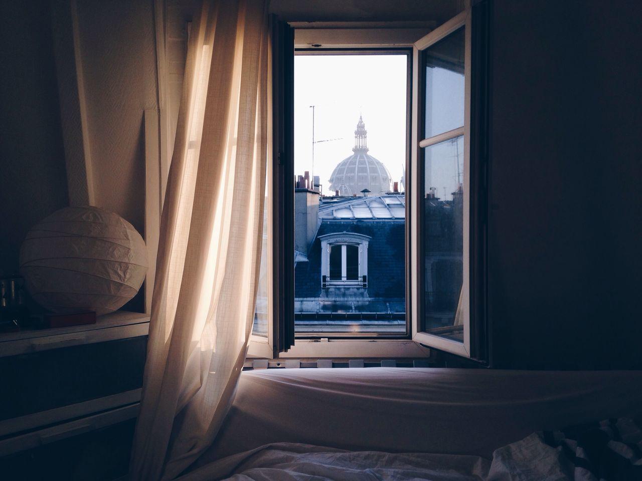 Buildings seen through bedroom window