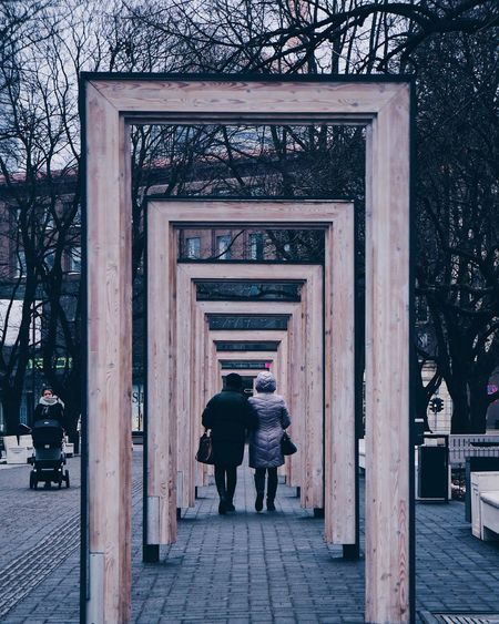 Freedom Square  Freedom Estonia Vacations Vacay Travel Winter Streetphotography Europe Couple Love Shape Geometry Rectangle Geometric Shape Architecture Built Structure Real People Building Exterior Lifestyles Full Length Entrance Adult Rear View Walking Men Women Unrecognizable Person Standing Street