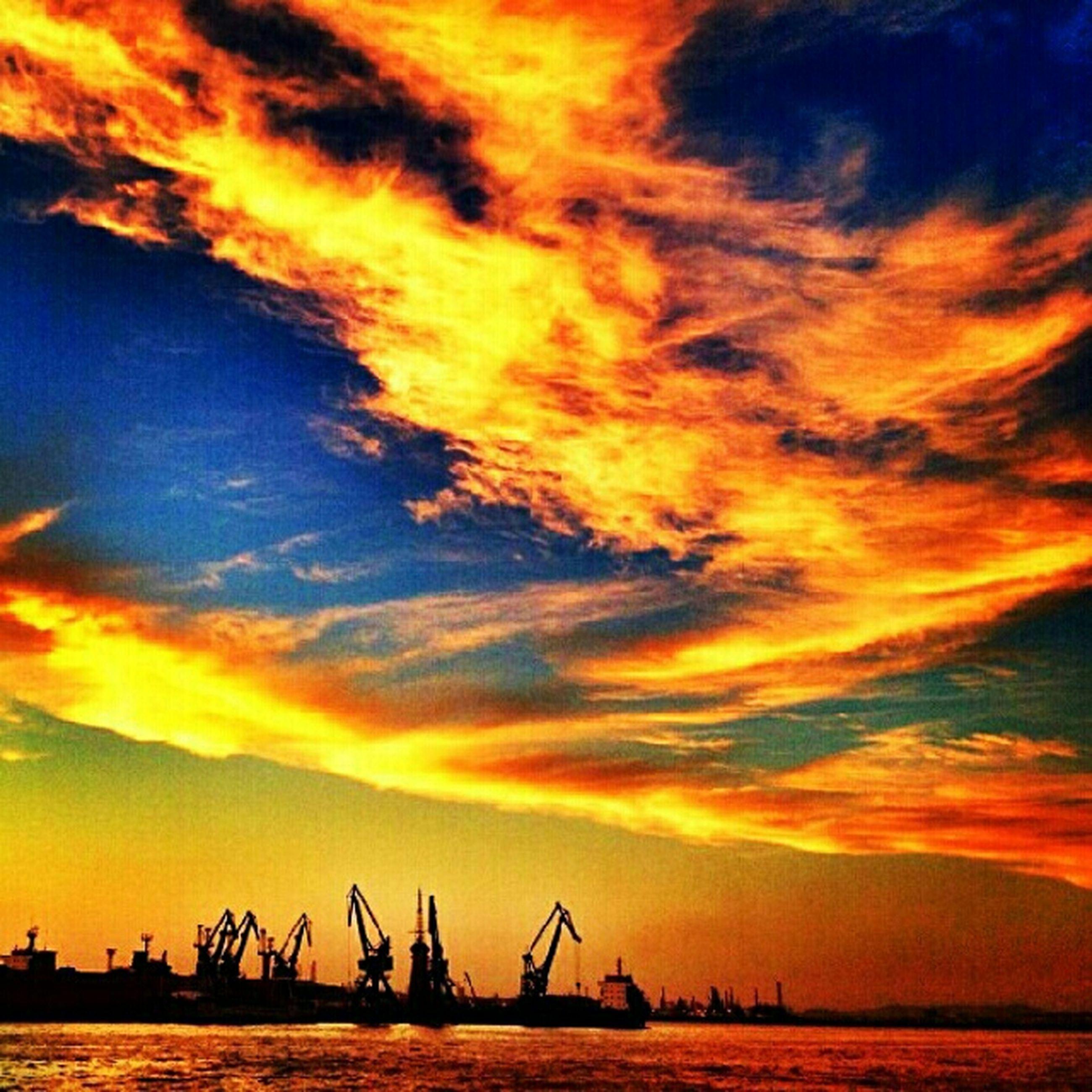 sunset, sky, silhouette, orange color, sea, cloud - sky, water, nautical vessel, beauty in nature, crane - construction machinery, dramatic sky, scenics, cloud, nature, tranquility, tranquil scene, waterfront, boat, harbor, transportation