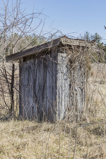 When Ya Gotta Go Architecture Bare Tree Building Exterior Built Structure Clear Sky Day Field Landscape Nature No People Outdoors Outhouse Rural Scene Sky Tree