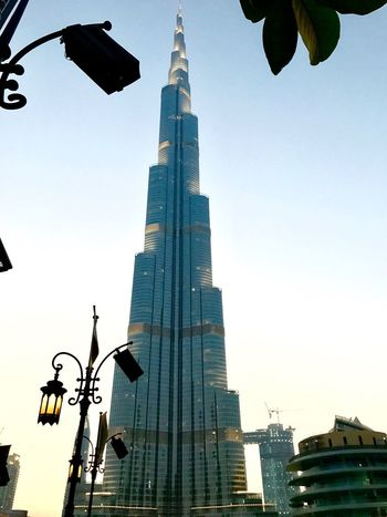 Burj Khalifa.... Architecture Building Exterior Built Structure Low Angle View City Traffic Light  Traffic Signal Guidance Skyscraper Outdoors Street Light Clear Sky Day Stoplight Road Sign City Life No People Modern Sky Architecture Spirituality Statue Low Angle View The Architect - 2017 EyeEm Awards The Great Outdoors - 2017 EyeEm Awards EyeEm Selects