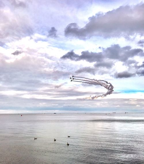 Sky Cloud - Sky Sea Water Flying Horizon Over Water Beach Outdoors Nature Scenics Airshow Day Mid-air No People Beauty In Nature Fighter Plane Vapor Trail Shotoniphone7plus