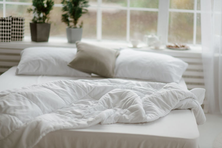 White lying on bed at home
