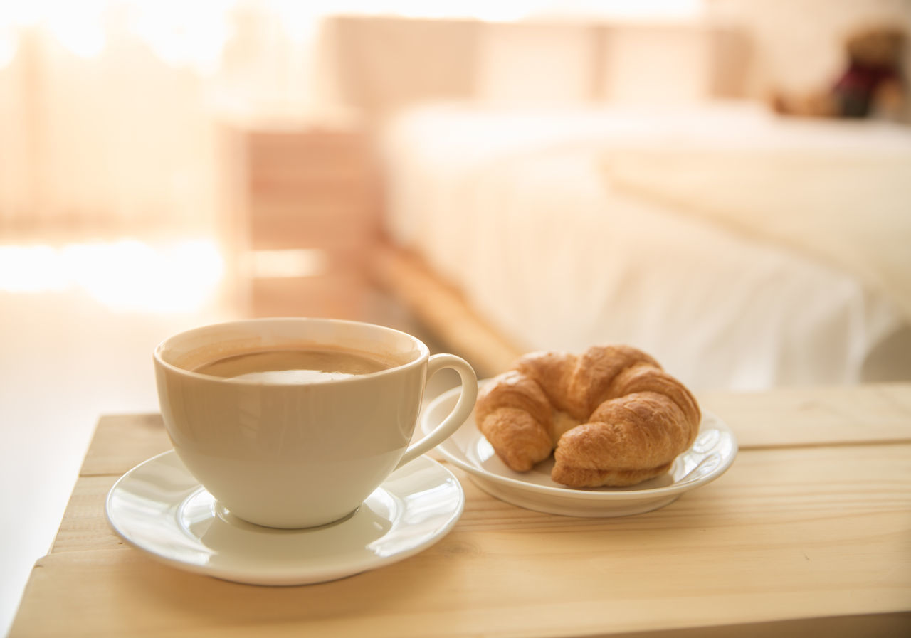 food and drink, mug, cup, coffee cup, coffee - drink, table, coffee, drink, refreshment, food, saucer, baked, still life, focus on foreground, indoors, crockery, freshness, croissant, plate, no people, french food, hot drink, temptation, breakfast, snack, tray, tea cup
